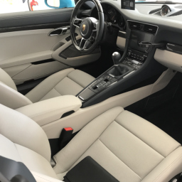 Interior car detailing expert cleaning and conditioning fabrics, leather, vinyl, plastic