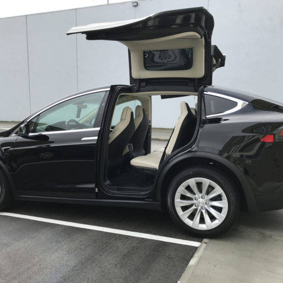 Opti Coat on Tesla Model X: side view with interior visible