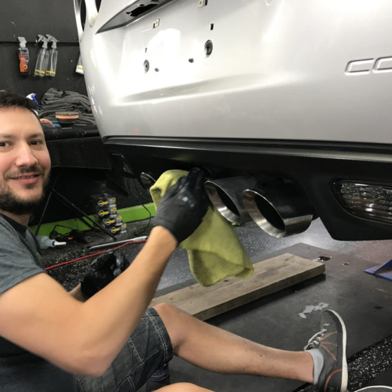 Igor Anisimov - lead detailer and owner of Gleamworks detailing Corvette tailpipes