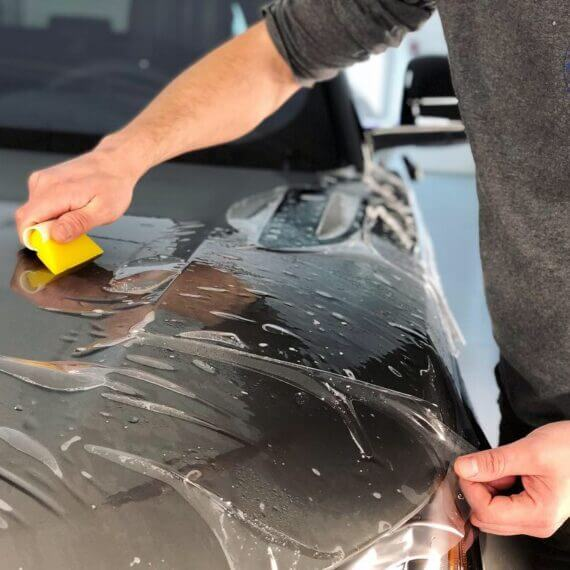 Paint Protection Film installation on hood Range Rover