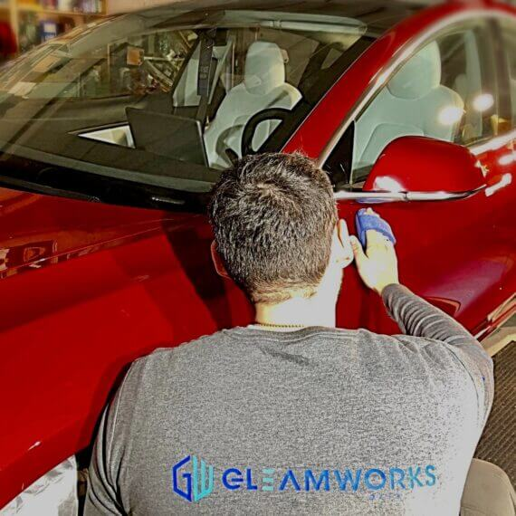 Tesla Model 3 Being coated with Opti-Coat at Gleamworks Detailing